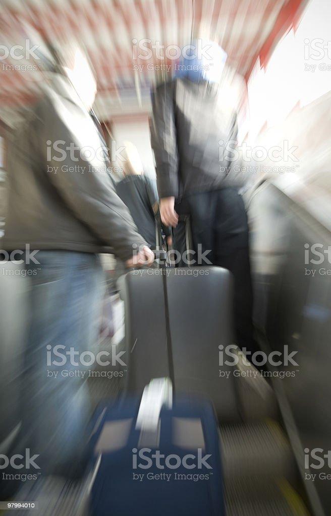 Men in escalator royalty free stockfoto