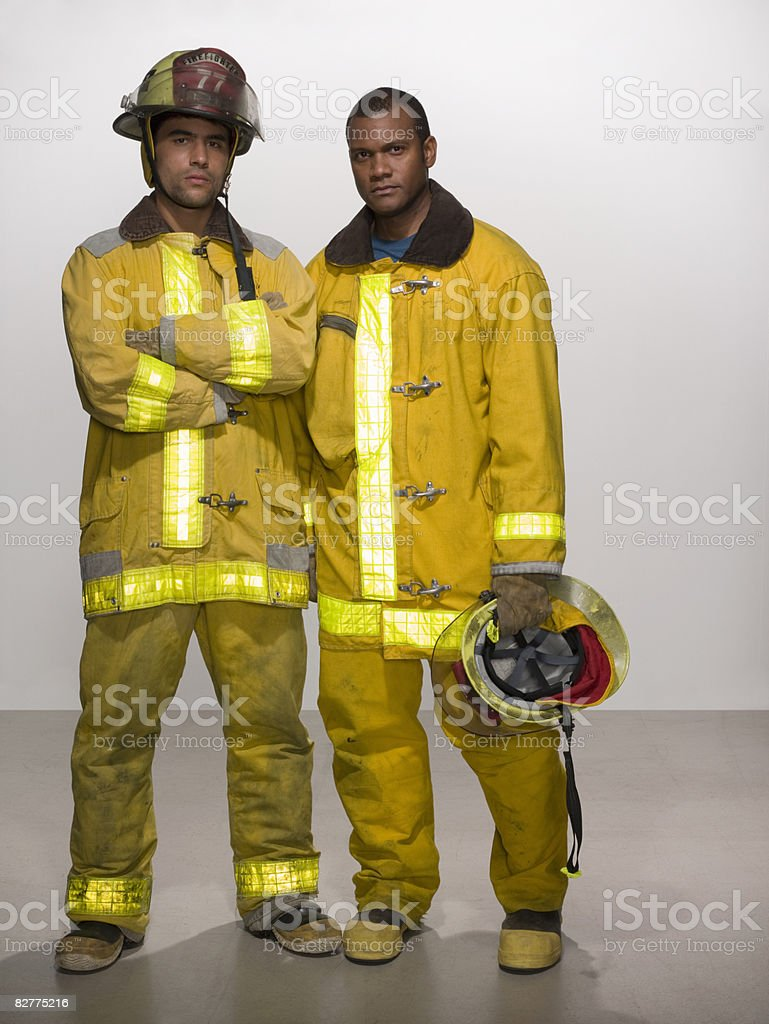 men in firefighting suits royalty free stockfoto