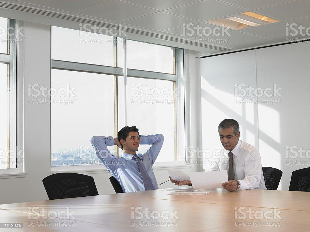 Men in meeting room stock photo