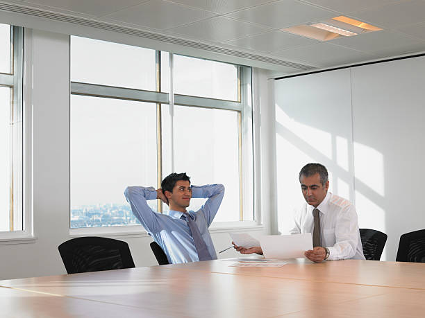 Men in meeting room stock photo