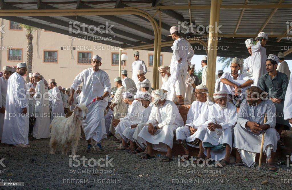 men in Nizwa goat market stock photo