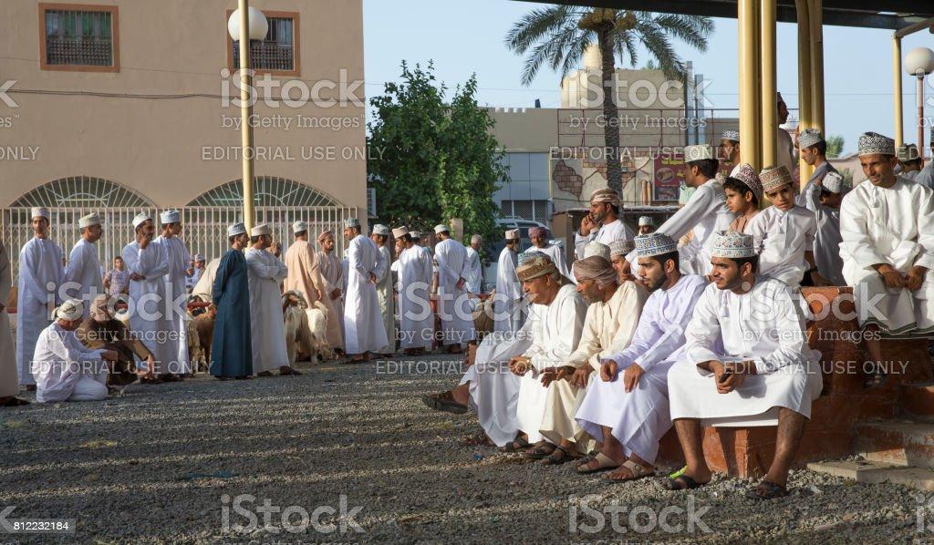 men in Nizwa goat merket stock photo