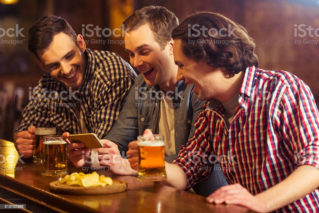 Men in pub stock photo