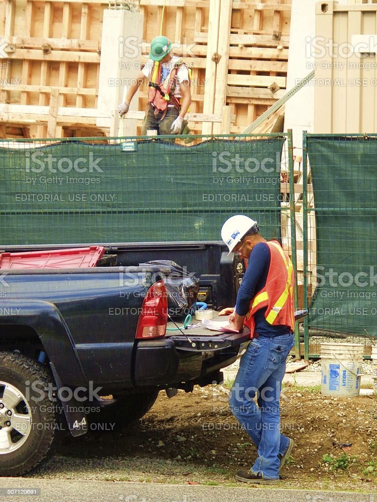 Men in safety vests at construction site stock photo