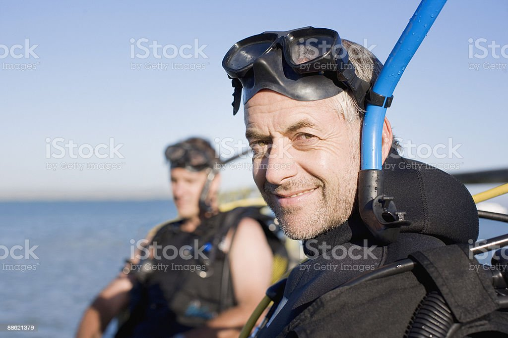 Men in scuba gear stock photo
