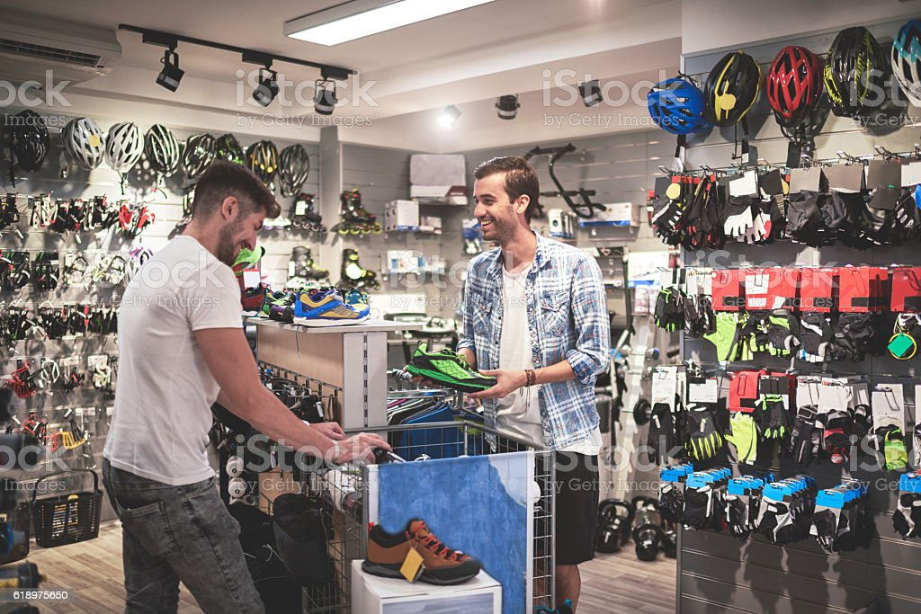 Men in sports store stock photo
