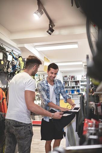 Men in sports store