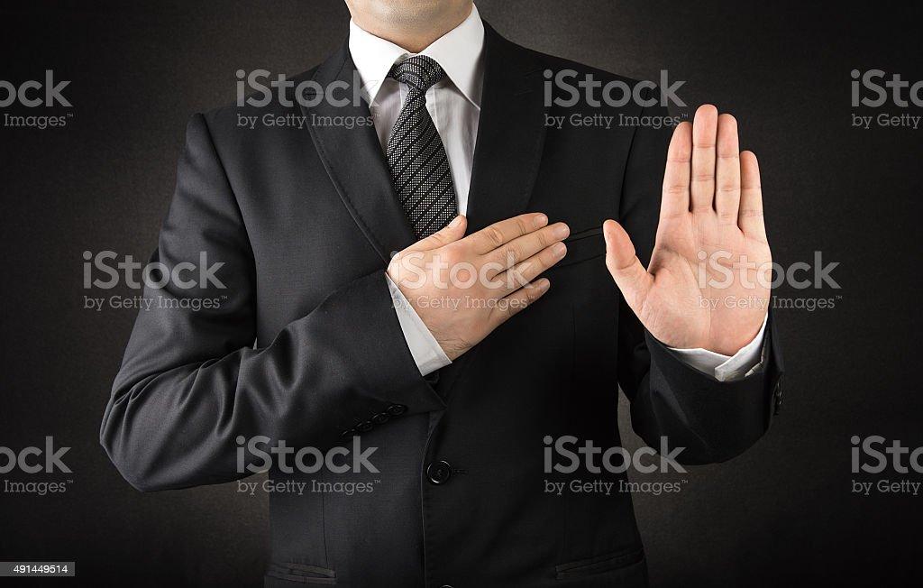 Men in suits taking oath stock photo