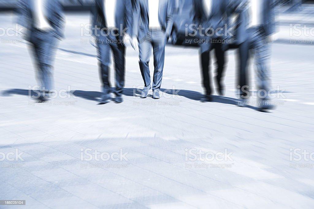 Men in suits walking royalty-free stock photo