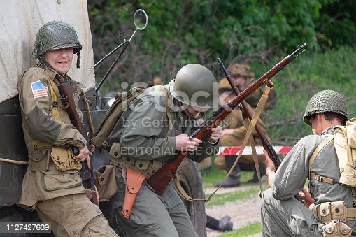 Kiev, Ukraine - May 09, 2018: Men in the form of American and British soldiers instigate a battle during historical reconstruction in honor of the anniversary of victory in World War II