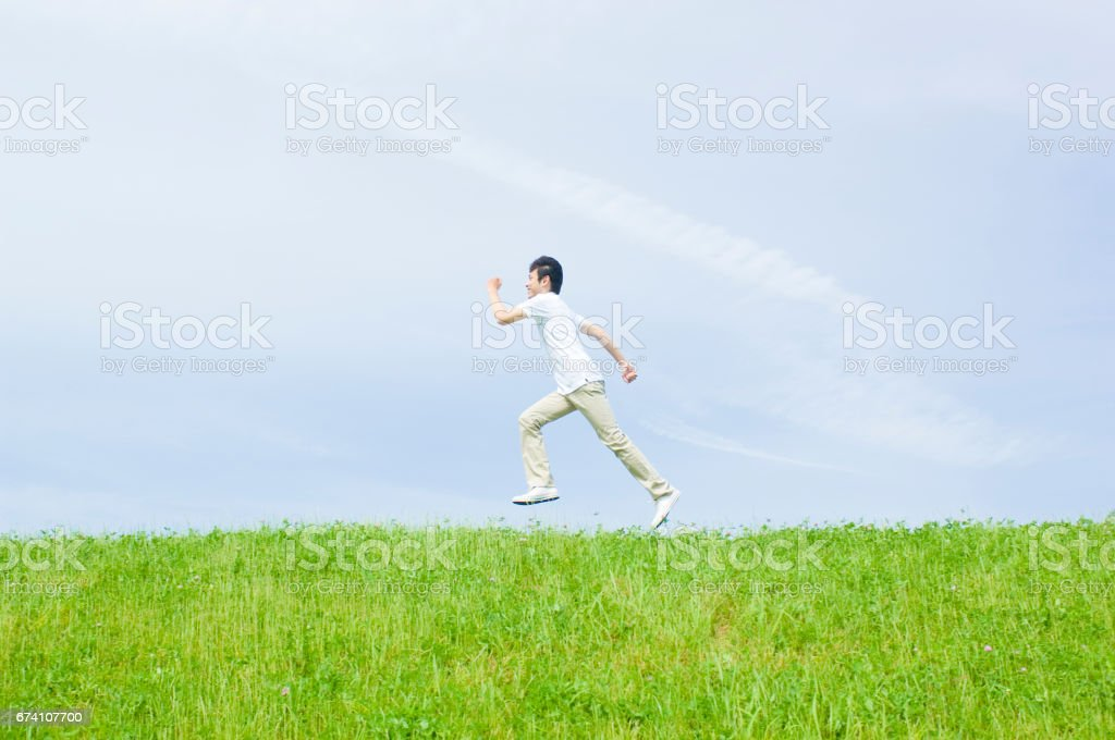Men jump at the top of the Hill royalty-free stock photo