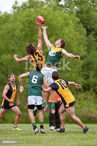 istock Men Jump For Ball In Amateur Australian Rules Football Game 506936511