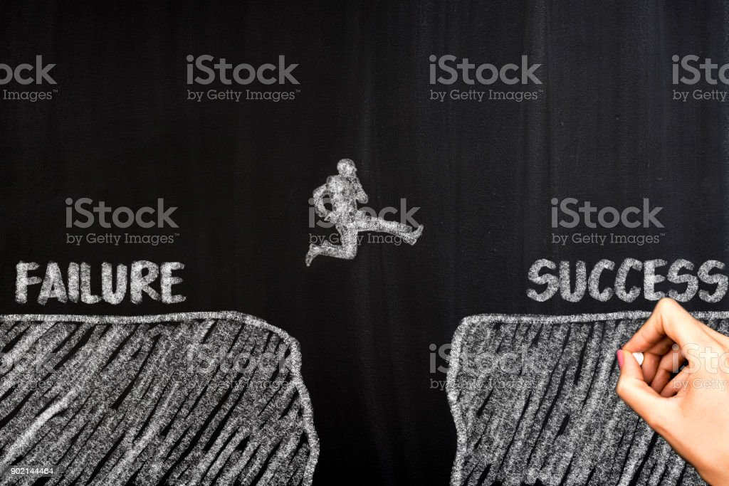 Men jump over failure Committed to success stock photo