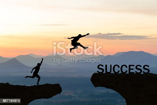 istock Men jump over silhouette failure commitment to success 887194974