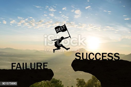 istock Men jump over silhouette hand hold flag best failure Committed to success. 901575690