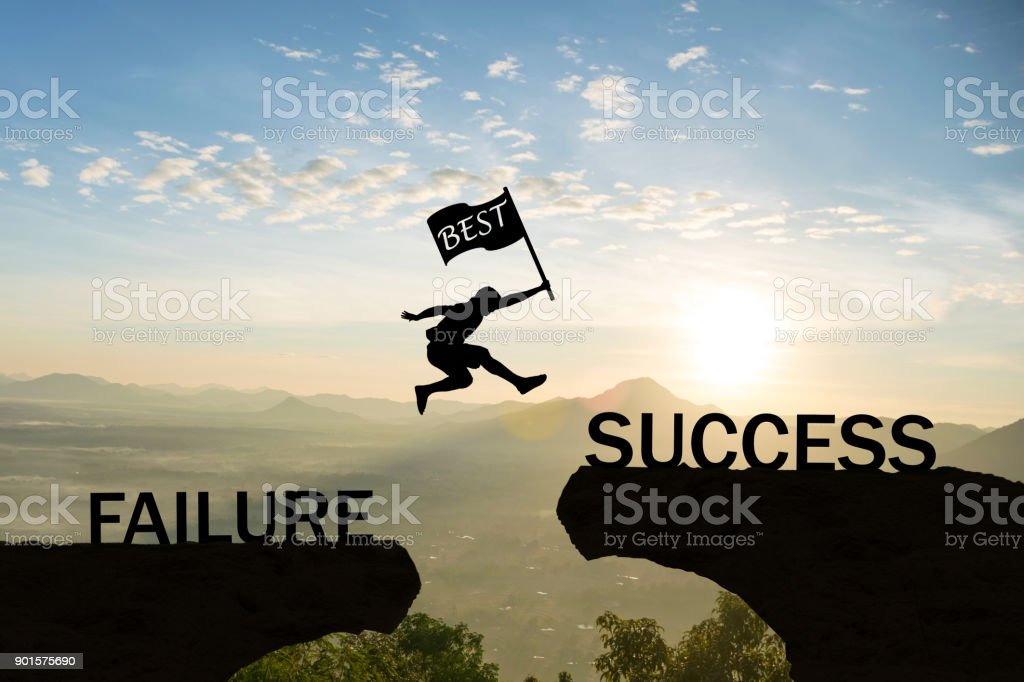 Men jump over silhouette hand hold flag best failure Committed to success. stock photo