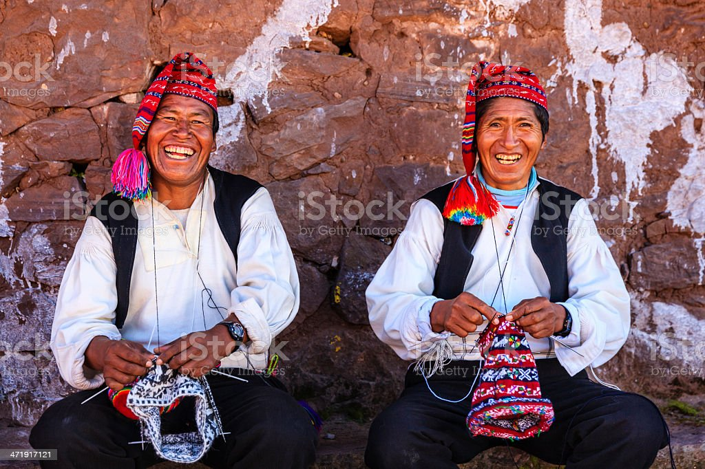 Men knitting on Taquile Island, Lake Titicaca, Peru stock photo