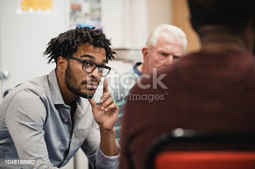 istock Men Listening in a Support Group 1048188962