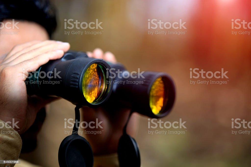 Men looking through binoculars stock photo