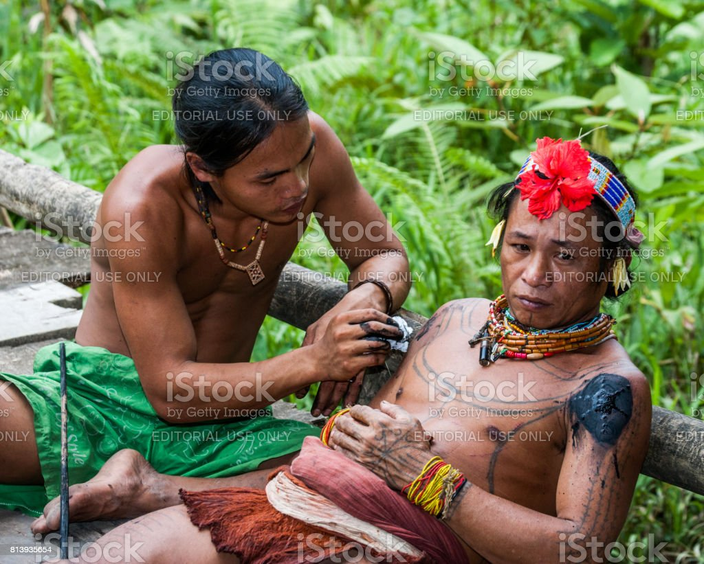 Men Mentawai tribe make tattoo. stock photo