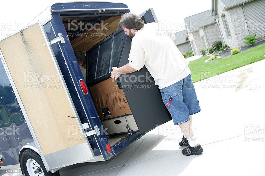 Men Moving Large Television royalty-free stock photo