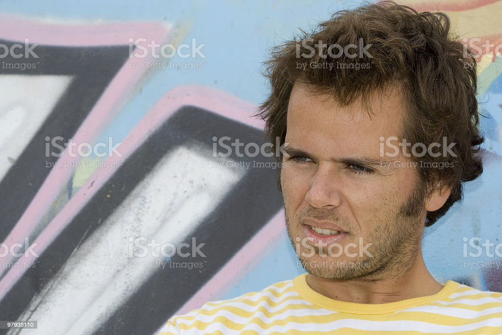 men next to a graffiti wall royalty-free stock photo