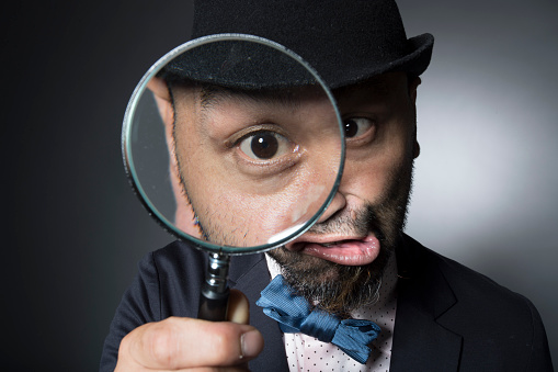 istock Men observing the eyeball in the magnifying glass 588960046
