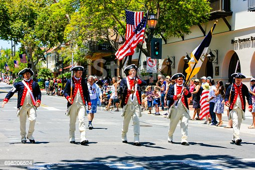 istock Men of the 1776 group march down State street at the July 4th parade in Santa Barbara California, USA 698206524