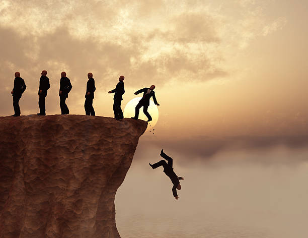 men on a cliff - cliff stock pictures, royalty-free photos & images