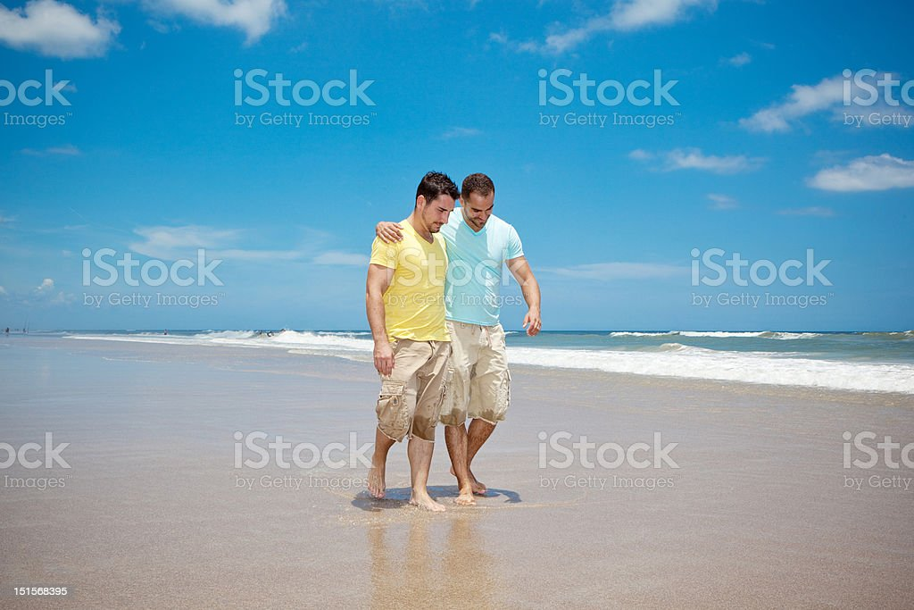 Men on beach royalty-free stock photo