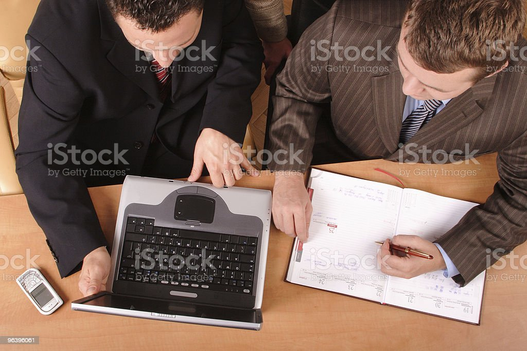 men over the desk with laptop and calender on - Royalty-free Adult Stock Photo