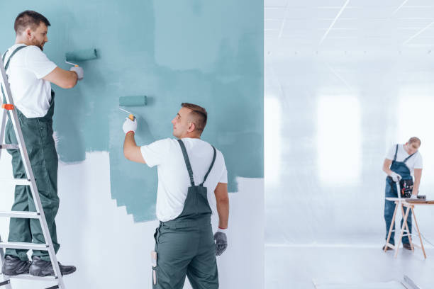 men painting empty home interior - painter stock photos and pictures