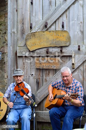 Omagh, County Tyrone, Northern Ireland, Sep., 2017. Men perform the instruments in Ulster American Folk Park in Northern Ireland.