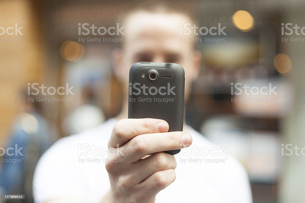 Men photographing with mobile phone royalty-free stock photo