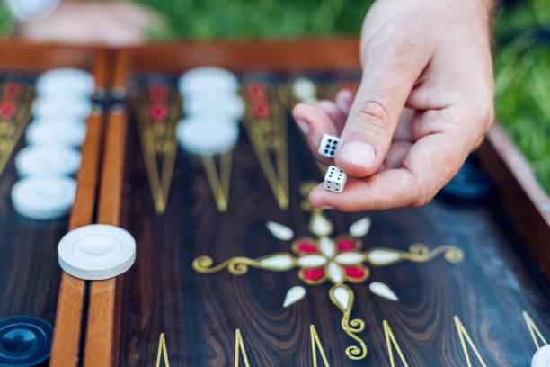 men playing backgammon - backgammon stock pictures, royalty-free photos & images