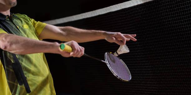 men playing badminton - bádminton deporte fotografías e imágenes de stock