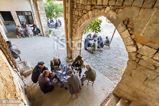 istock Men playing cards, in Adiyaman, Turkey. 821330466