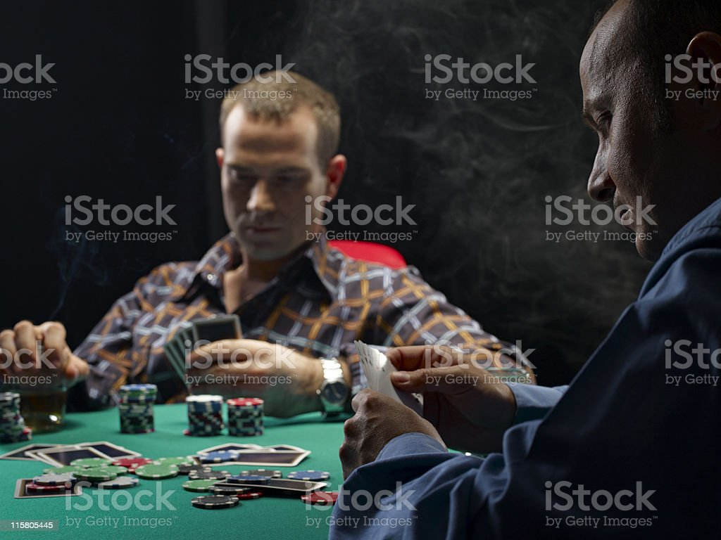 Men playing cards royalty-free stock photo