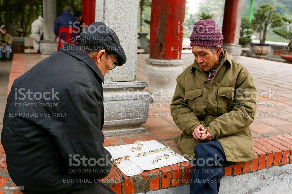 Men playing chess in Hanoi stock photo