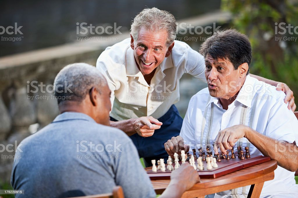 Men playing chess in park royalty-free stock photo
