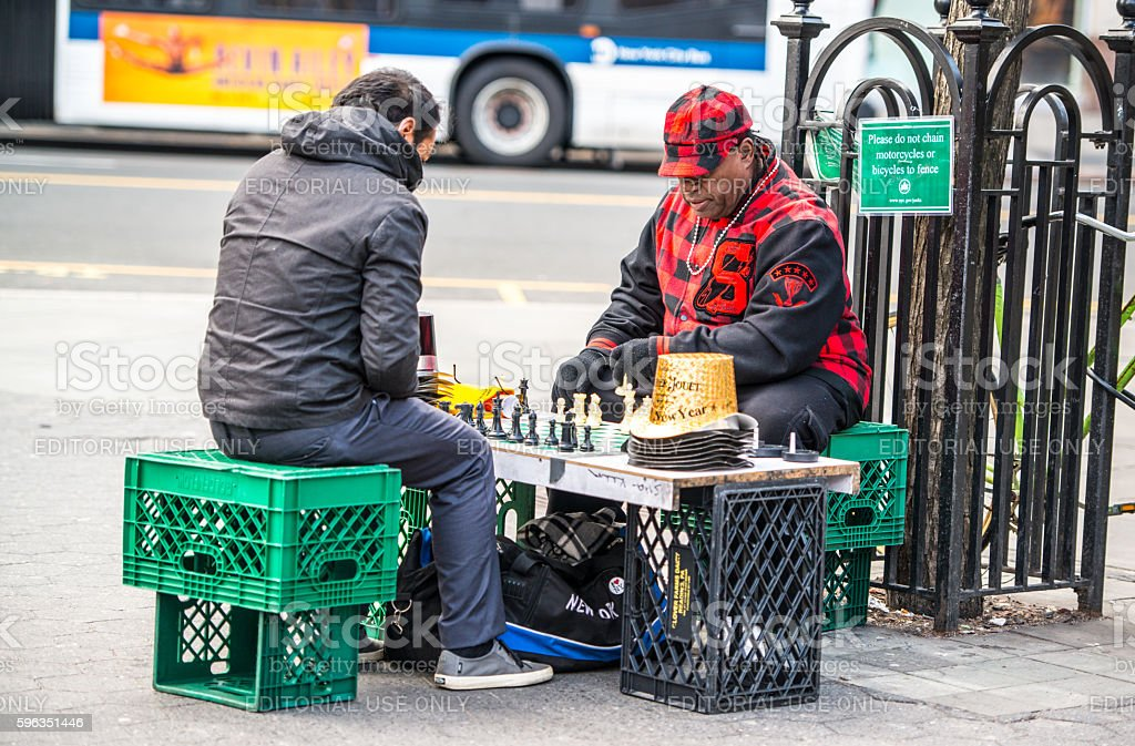 Men playing chess on Union Square, NYC royalty-free stock photo