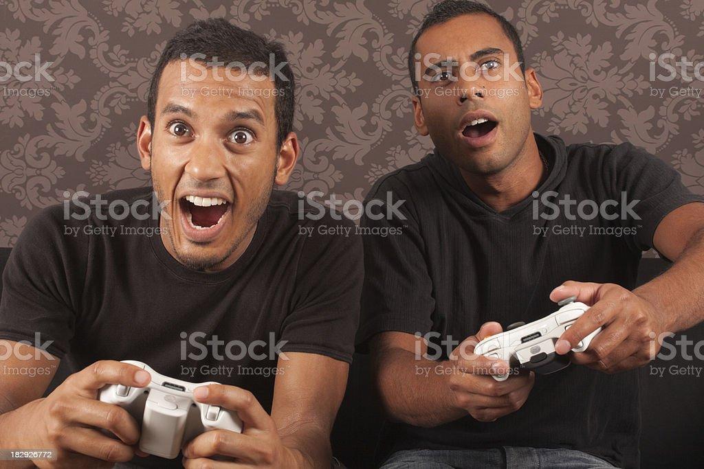 Men Playing Computer Games royalty-free stock photo