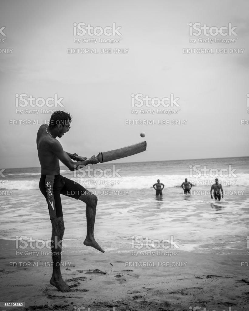 Men playing cricket at beach in Mirissa, Sri Lanka stock photo
