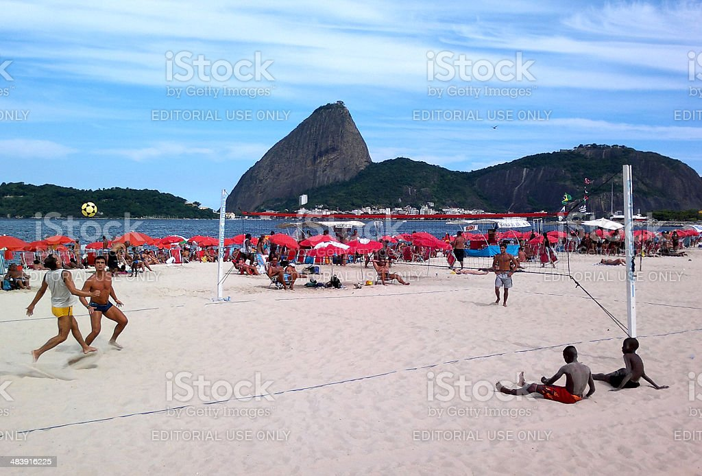 Men playing footvolley in Flamengo Beach stock photo