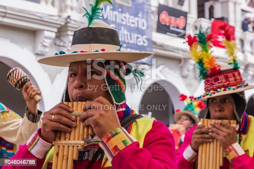 Men playing panpipes at Oruro Carnival in Bolivia. The traditional and popular Oruro Carnival is an UNESCO's Masterpieces of the Oral and Intangible Heritage of Humanity. It is held every year at the streets of Oruro city on the Altiplano of Bolivia.
