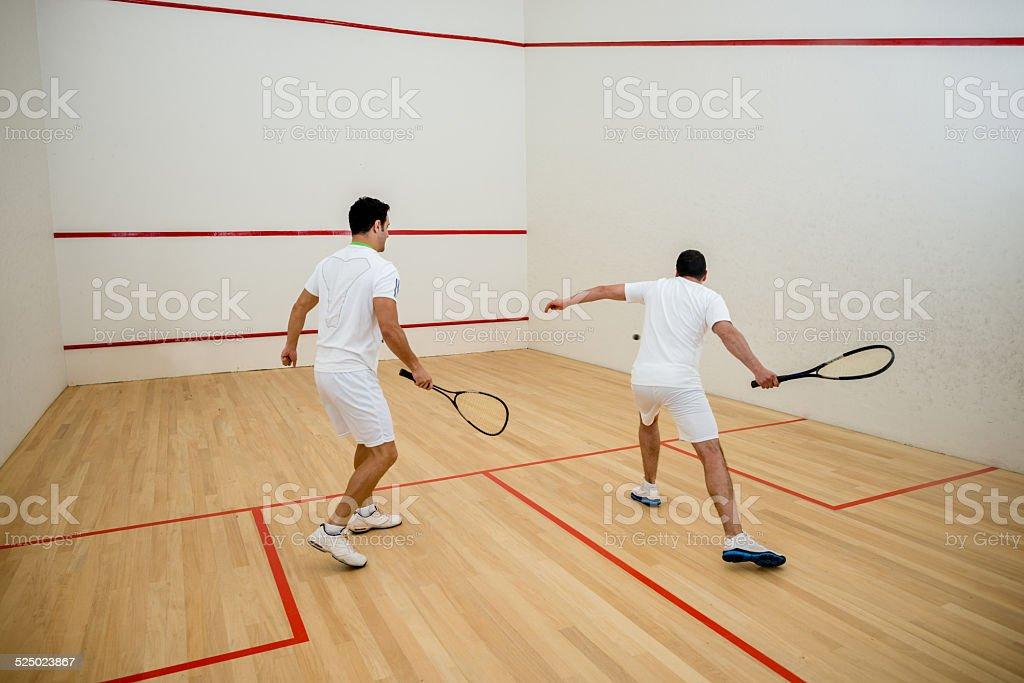 Men playing squash stock photo