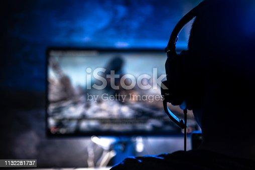 istock Men playing video games 1132281737
