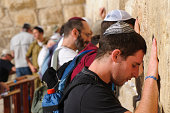 Jerusalem, Israel - October 20, 2010: Jewish men pray at the Western Wall. Also called the Wailing Wall, it is the holiest site in Judaism.