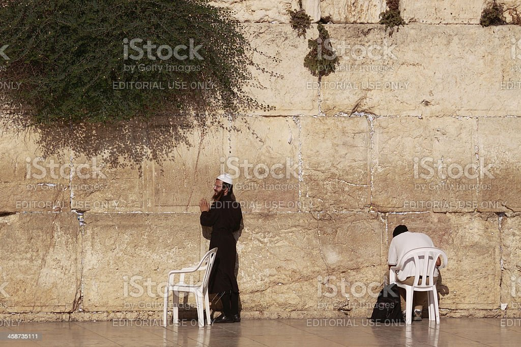 Men praying at the Western Wall stock photo