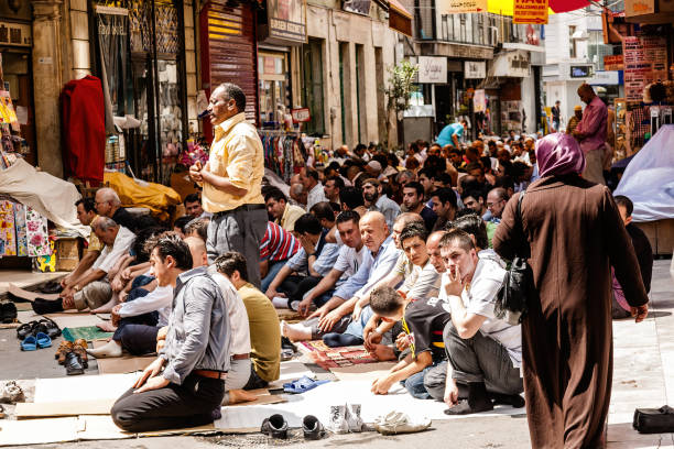 Men praying on the street of Istanbul stock photo